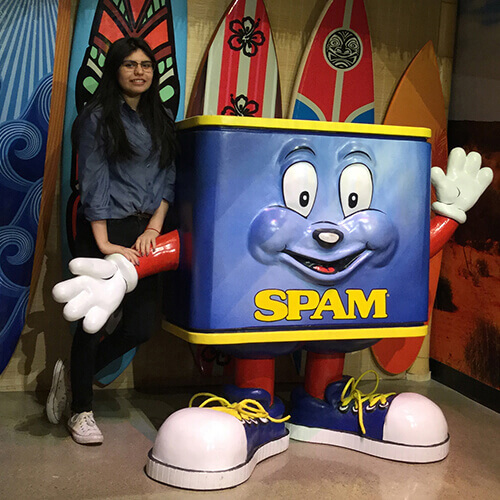 SPAMbassador Abi in SPAM museum with SPAM mascot.